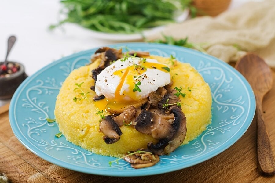 Breakfast polenta with poached eggs and garlicky sautéed mushrooms.