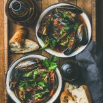 mussels in a bacon, tomato, roasted red pepper, garlic, and red wine sauce