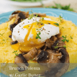polenta topped with poached egg and sautéed garlic butter mushrooms