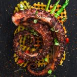 Grilled Mediterranean octopus salad with waffle-cut sweet potato fries.