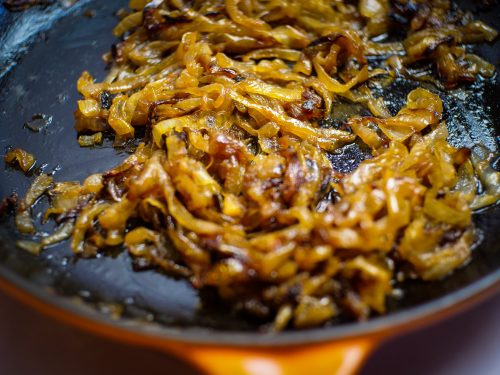 Smoked and caramelized onions in a cast iron pan