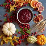 fresh cranberry sauce surrounded by fall decor