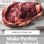 raw ribeye steak on board