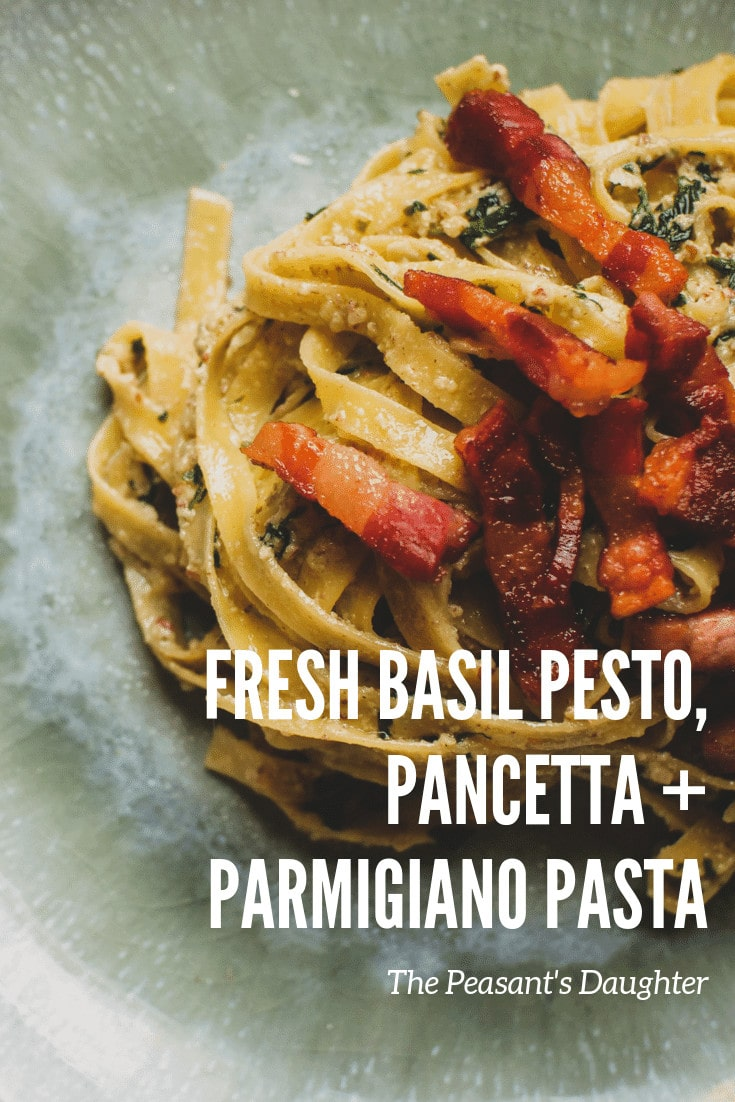 a plate of fresh pasta sauce with pesto and pancetta