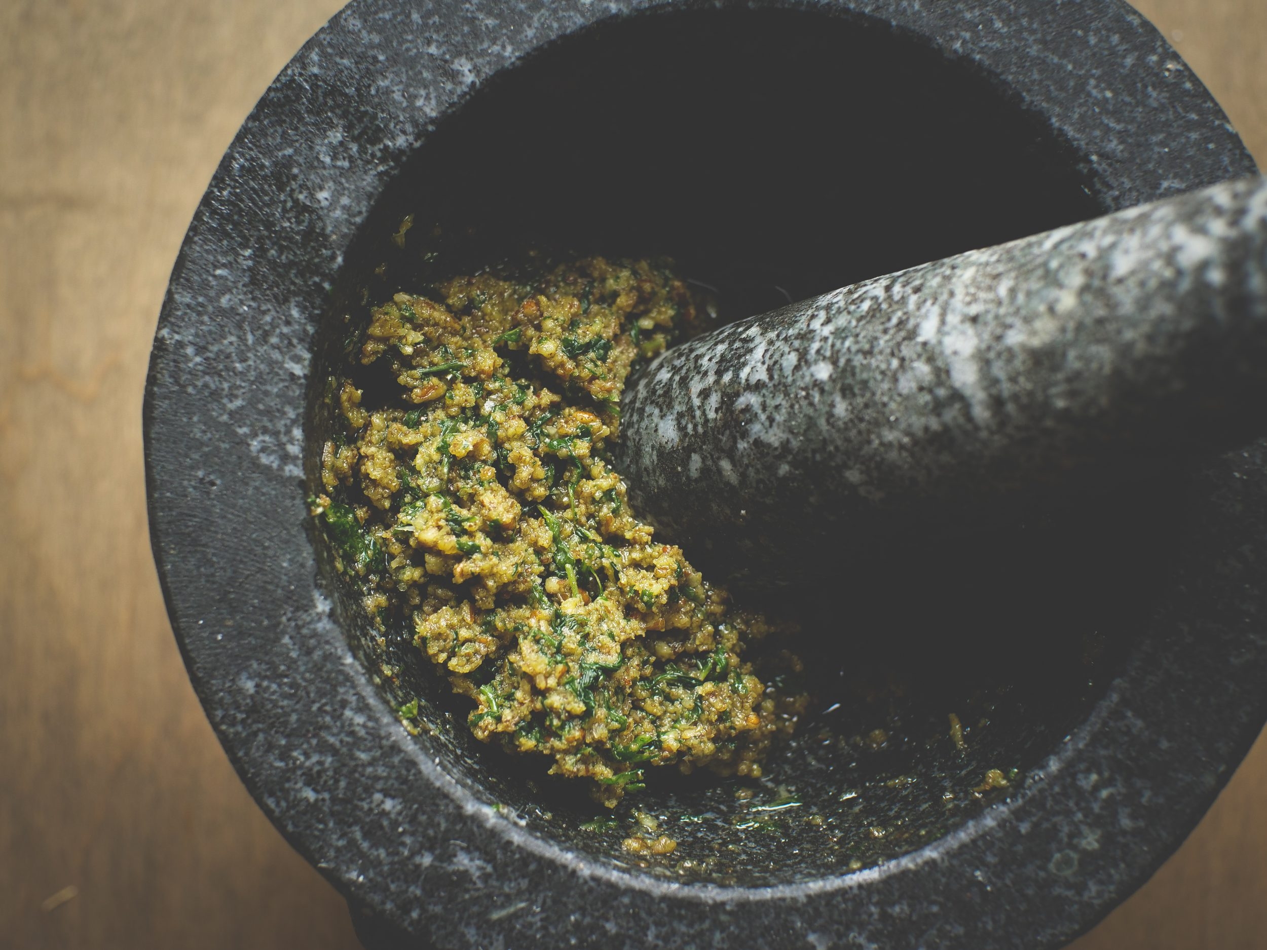 italian basil pesto made in mortar with pestle