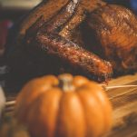 smoked turkey on table with fall decor