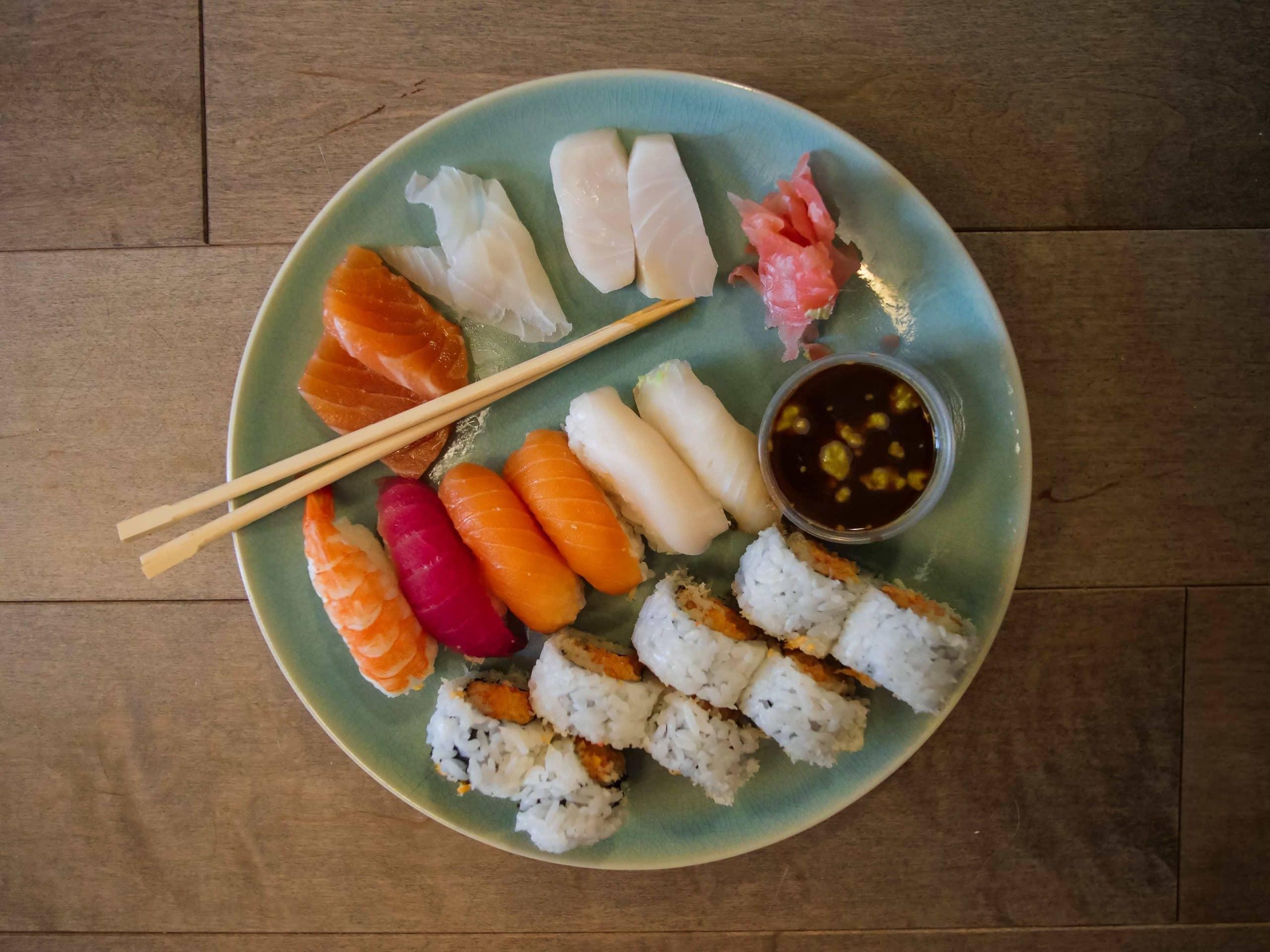 platter of sashimi and sushi