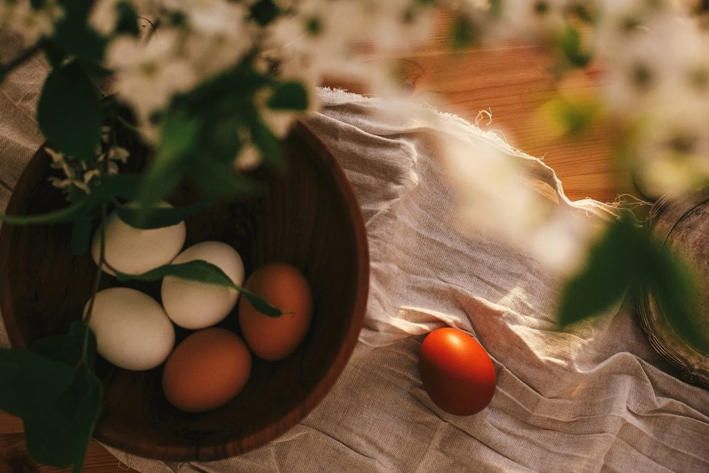 freshly collected eggs on a table
